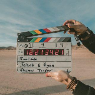 Filmklappe am Strand